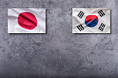 South Korea and Japan flags. South Korea and Japan flag on concrete background