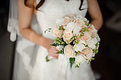 Fiancee in a beautiful white dress holding a bouquet