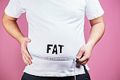 belly fat, glutton. Fat man with measure tape
