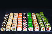 Sushi rolls assortment, delicious appetizing japanese food