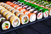 Great assortment of tasty multicolored maki sushi rolls, selecti