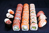 Torched salmon and tuna sushi set, food background