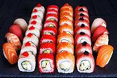 Maki and nigiri sushi set with caviar on slate