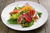 Mediterranean salad of prosciutto and vegetables