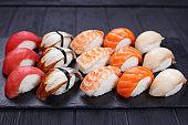 Nigiri sushi with salmon, grouper, eel, tuna and prawn, served o