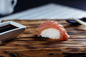 Appetizing fresh nigiri with tuna served on wooden rustic table,