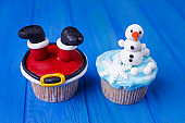 New year or Christmas party sweets. Delicious cupcakes with Sant