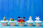 Delicious New Year or Christmas cupcakes set with bright decorat