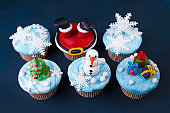 Merry Christmas and Happy New Year sweets set. Tasty cupcakes wi