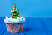 Funny homemade New Year party cupcake with fir tree decoration m