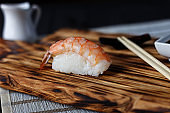 One shrimp sushi nigiri with delicious prawn served on wooden ru