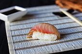 One shrimp sushi nigiri with delicious prawn served on white str