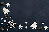 Christmas decorations on black table, copy space