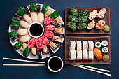 Tasty appetizing multicolored sushi set with wide assortment of
