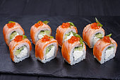Delicious philadelphia sushi roll with grilled salmon and caviar