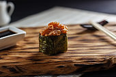 Delicious fresh sushi with spicy salmon served on wooden rustic