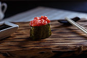 Appetizing fresh one nigiri sushi with spicy tuna and caviar, se
