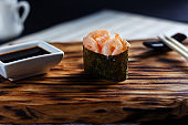 Japanese food. Nigiri sushi with spicy shrimps, served on wooden