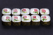 Futomaki sushi roll with tuna and cream cheese, portion of delic