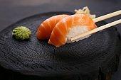 Eating sushi. Delicious Japanese cuisine, nigiri sushi with salm