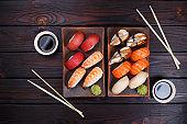 Nigiri sushi with salmon, grouper, eel, tuna and prawn on clay p