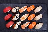 Nigiri sushi set with salmon, grouper, eel, tuna and prawn, flat