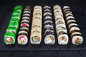 Delicious appetizing set of traditional uramaki and futomaki sus