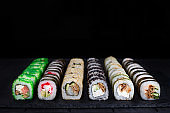 Great set of traditional uramaki and futomaki sushi rolls with w