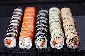 Japanese assorted tasty fresh sushi set served on black slate, c