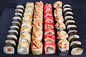 Tasty multicolored maki sushi rolls set. Japanese food, sushi re