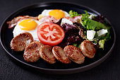morning food, roasted eggs, sausage and salad