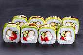 Tasty and delicious uramaki sushi rolls with smoked eel, unagi s