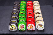 Tasty appetizing  multicolored uramaki sushi rolls set with wide