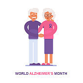 An elderly man and his wife with Alzheimer's disease support each other.World Alzheimer's Month text