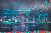 Stock market price with modern illuminated skyscrapers