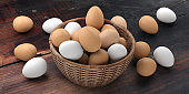 3d rendering white and brown eggs in a basket