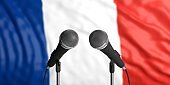 France flag background with two microphones in front of it. Close up view. 3d illustration