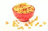 Bowl with corn flakes on white background