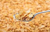 Spoon on corn flakes background