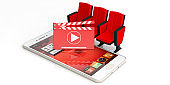 Cinema movie clapper board, theater chairs and a smartphone isolated on white background. 3d illustration