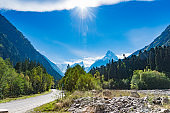 Mountain peak Dombay. National Park, Russia, Karachay-Cherkessia. Green coniferous forest