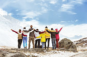 Big group happy friends mountains travel
