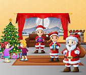 Happy three santa claus with kids decorating christmas tree