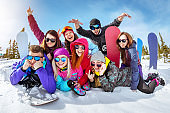 Happy friends having fun at ski resort