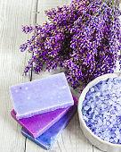 Natural soap, lavender, salt on a wooden board, hygiene items fo