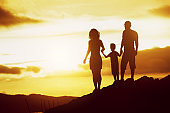 Family son sunset silhouettes sky