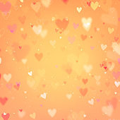 Valentines Day background with hearts and bokeh lights.Orange love background with hearts and sparkle lights.