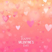 Valentines Day background with hearts and bokeh lights. Pink love background with hearts and sparkle lights.