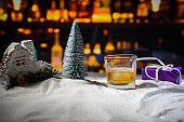 Plush Santa Claus with single malt whisky in glass, Symbol of Christmas holiday, Xmas set, decoration