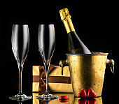 Background Valentine's Day with Champagne and chocolate candies